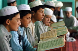 Afghan boys read the Quran at the Abdull