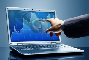 Finger touches the screen and checking the stock market